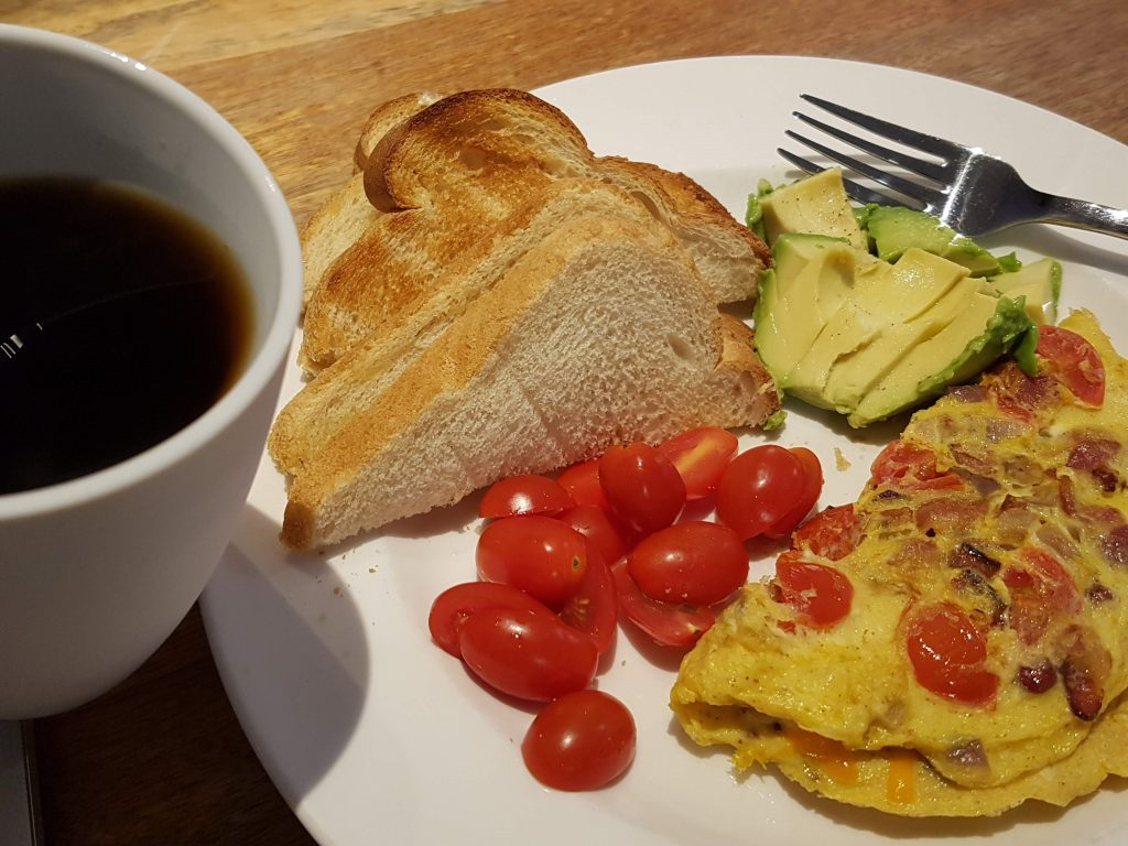 Omlette served with Toast, tomoatoes and Avocado plus Coffee