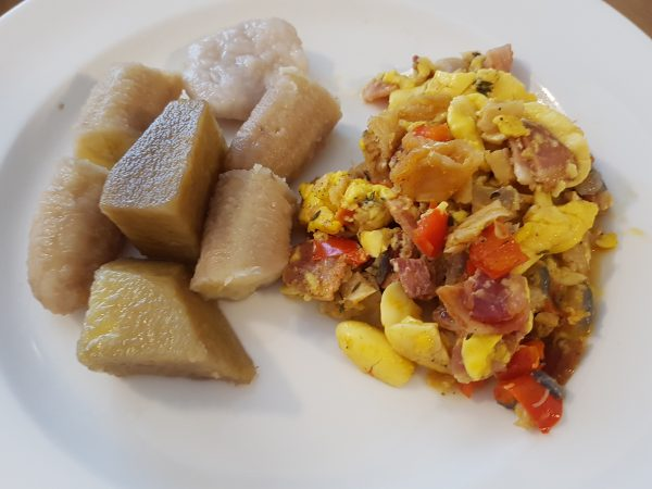 Ackee and Saltfish served with Boiled Yam, Green Banana and Dumpling