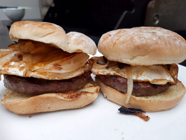 2 Simple Burgers with Fried Eggs and Caramelized Onion